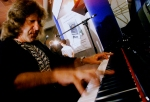 FILE - In this Aug. 12, 1999 file photo, musician Keith Emerson plays the new Van Koevering Interactive Piano, designed by electronic engineer Bob Moog, in Beverly Hills, Calif. Emerson, the keyboardist and founding member of the 1970s progressive rock group Emerson, Lake and Palmer, died Thursday, March 10, 2016, at home in Santa Monica, Calif. He was 71. (AP Photos/Damian Dovarganes, File)
