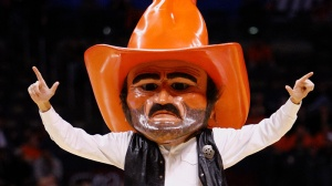 Oklahoma State mascot Pistol Pete gestures in the first half of an NCAA men's basketball game against Alabama in Oklahoma City, Saturday, Dec. 18, 2010. (AP Photo/Alonzo Adams)