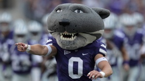 "Kansas State mascot ""Willie the Wildcat"" leads the team onto the field before an NCAA college football game against Kent State Saturday, Sept. 17, 2011, in Manhattan, Kan. (AP Photo/Charlie Riedel)"