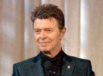 FILE - In this June 5, 2007 file photo, singer David Bowie accepts the lifetime achievement award at the 11th Annual Webby Awards in New York. Sotheby's is to sell more than 200 pieces from David Bowie's extensive art collection, including works by Damien Hirst and Jean-Michel Basquiat. The musician, who died in January 2016, was an avid collector, and served on the editorial board of Modern Painters magazine. (AP Photo/Stephen Chernin, File)