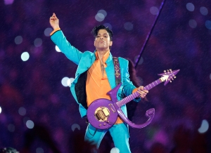 """FILE - In this Feb. 4, 2007 file photo, Prince performs during the halftime show at the Super Bowl XLI football game at Dolphin Stadium in Miami. Widely acclaimed as one of the most inventive and influential musicians of his era with hits including """"Little Red Corvette,"""" ''Let's Go Crazy"""" and """"When Doves Cry,"""" he was found dead at his home on Thursday, April 21, 2016, in suburban Minneapolis, according to his publicist. He was 57. (AP Photo/Chris O'Meara, File)"""